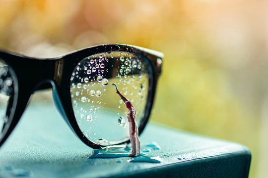 Vision Concept. Miniature Cleaner Wipe out Many Droplet on Eyeglasses to Clear