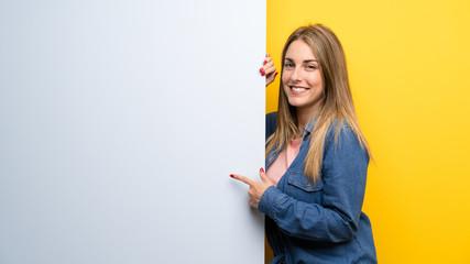 Fototapeta Happy Young woman holding an empty placard obraz