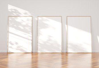 Three wooden frame leaning in wooden interior mockup 3D rendering