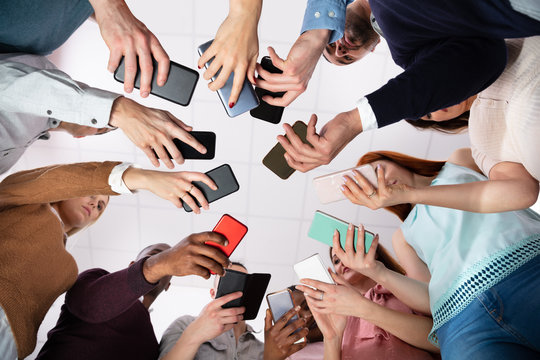 Low Angle View Of Hands Holding Cellphone