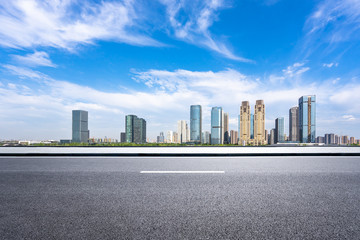 Wall Mural - city skyline with empty road