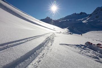 Ski tracks on the mountain side close to ski track