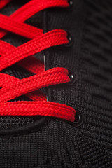 Closeup view of sport shoe. Red shoelaces closeup.