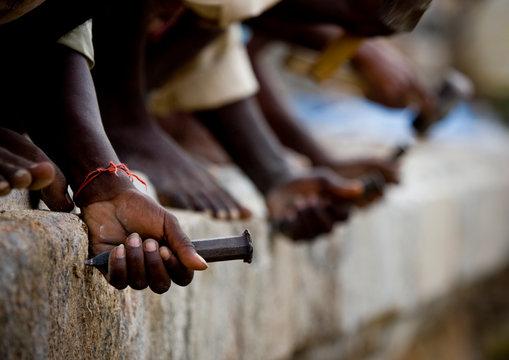 Hands Of Workers Cutting Stones With A Chisel At The Brihadishwara Temple, Gangaikondacholapuram, India