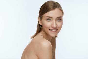 Beauty. Woman model with fresh skin and white smile portrait