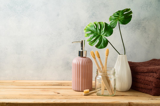 Eco friendly bamboo toothbrush on wooden table