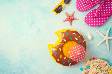 Summer holiday vacation background with orange juice and beach accessories.