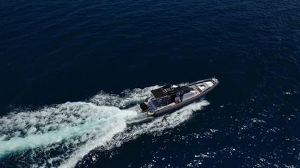 Aerial top view luxury inflatable rib speed boat cruising in Aegean deep blue open sea