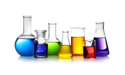 Set of different lab glassware with color liquid isolated on white
