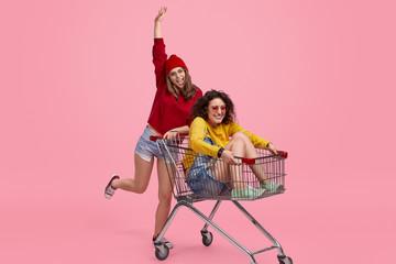 Friends having fun with shopping cart
