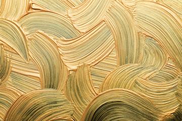 Golden paint brush strokes as background, closeup