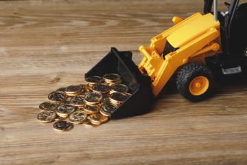 backhoe tractor rake up money coins