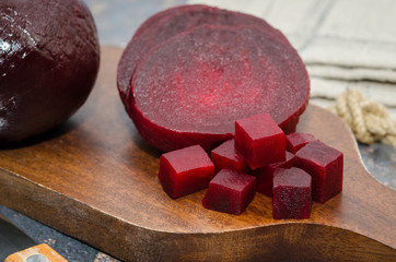 Sliced cooked beetroot on a wooden board