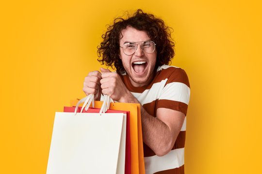 Excited male with shopping bags