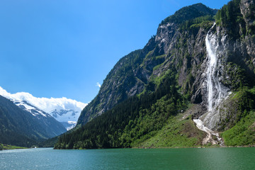 Wall Mural - Waterfall Mountain Lake Green Photo taked at  Stillup Lake, Austria, Tyrol