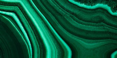 The green malachite. An ornamental stone. Photo texture. Macro. Wall mural
