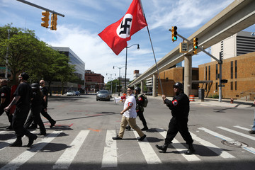 Members of the National Socialist Movement demonstrate against the LGBTQ event Motor City Pride in Detroit