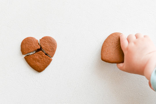 baby hands, fragile heart, health care, love and family concept, world heart day
