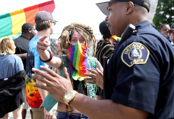 Counter-protesters are blocked by law enforcement as members of the National Socialist Movement demonstrate against the LGBTQ event Motor City Pride in Detroit