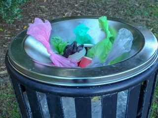 Plastic bags waste in metal bin