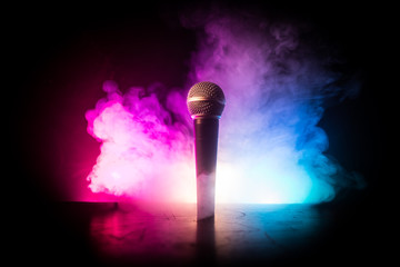 Microphone karaoke, concert . Vocal audio mic in low light with blurred background. Live music,...