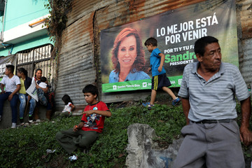 An election banner with an image of Torres is displayed during a rally in Guatemala City