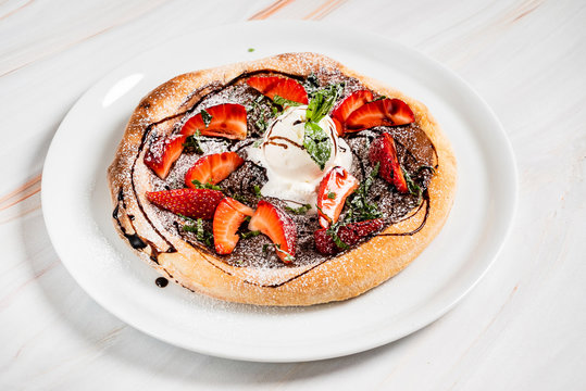strawberry pizza with chocolate and ice cream