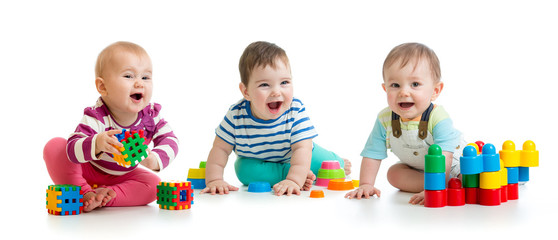 Nursery babies toddlers playing with color toys isolated on white background