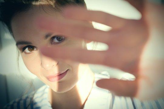 Woman shielding her eyes from sun