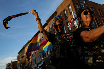 Participants take part in the Brooklyn Pride Twilight Parade in Brooklyn