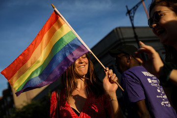 A participant takes part in the Brooklyn Pride Twilight Parade in Brooklyn