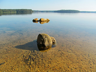Wall Mural - Summer idyllic landscape with beautiful lake. Calm transparent water surface with stones and sandy bottom on a bright quiet day. Lake Elovoe (Spruce Lake), South Ural, Russia.