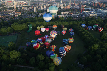 Hot air balloons take off from Battersea Park in London