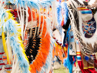 Close Up of Quill and Orange, Blue and Yellow Feather Bustle at Pow Wow