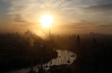 Sun rises over the city of London, as seen from a hot air ballon