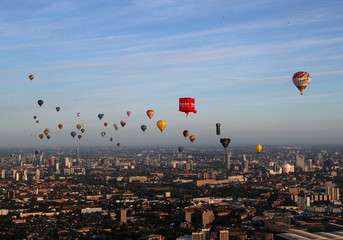 Hot air balloons fly over London during the Lord Mayor's Hot Air Balloon Regatta, in London
