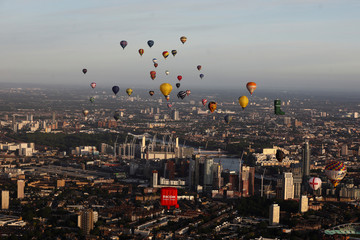 Hot air balloons fly over London as a part of the  Lord Mayor's Hot Air Balloon Regatta, in London