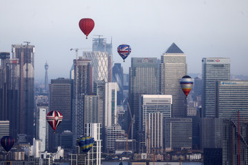 Hot air balloons fly over Canary Wharf during the Lord Mayor's Hot Air Balloon Regatta, in London