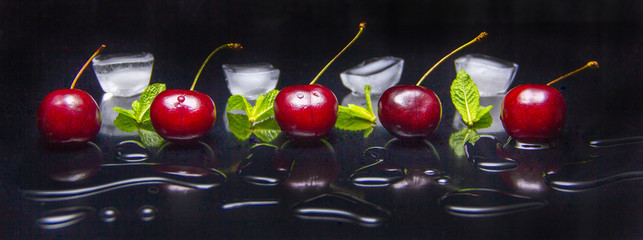 fresh cherries with mint leaves and pieces of ice Fototapete