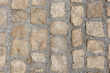 Old stone pavement texture. Granite cobblestones pavement background. Abstract background of old cobblestone