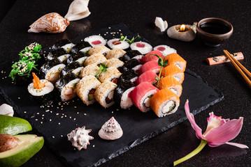 Foto op Plexiglas Sushi bar sushi on the black backround