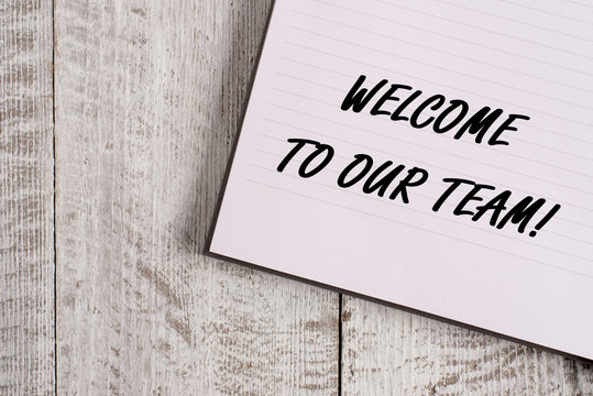 Conceptual hand writing showing Welcome To Our Team. Concept meaning introducing another demonstrating to your team mates Notebook stationary placed above classic wooden backdrop