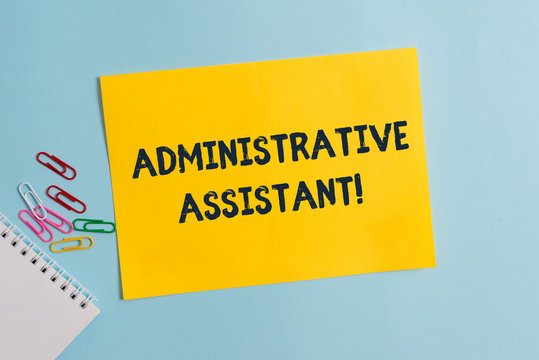 Text sign showing Administrative Assistant. Business photo showcasing Administration Support Specialist Clerical Tasks Plain cardboard and writing equipment placed above pastel colour backdrop