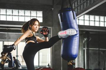 Athlete woman doing kick boxing training