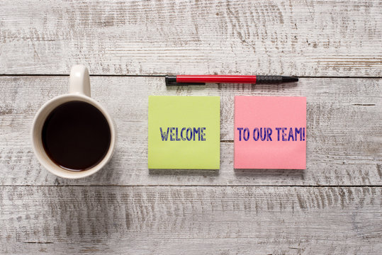 Text sign showing Welcome To Our Team. Business photo text introducing another demonstrating to your team mates Stationary placed next to a cup of black coffee above the wooden table