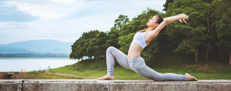 Asian woman doing yoga fitness exercise