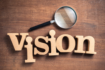 VISION word with Magnifying Glass