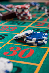 Roulette table with casino chips, selective focus