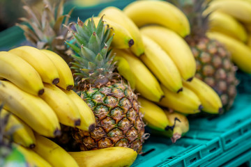 Fresh Fruits in Market.Healthy fruits Banana and Pineapple in the Grocery.