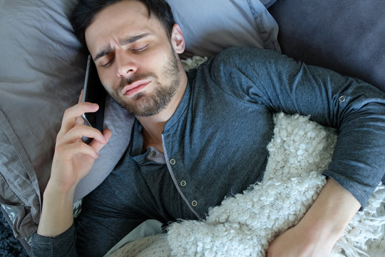 Sick man calling by phone